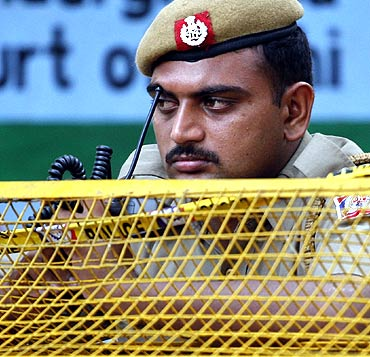 A policeman keeps guard outside the Delhi high court after Wednesday's bomb blast in New Delhi.