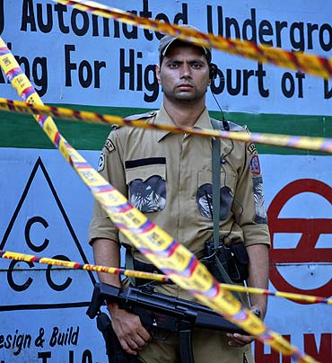 A special weapons and tactics member of the Delhi police force stands guard outside the high court
