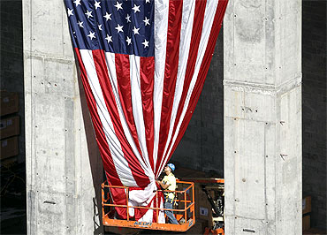 A worker holds up a US flag at the World Trade Centre construction site in New York