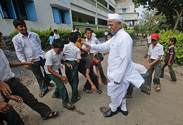 Hazare interacts with school children in his village