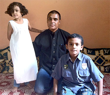Mohammed Jaweed Azmath with his children