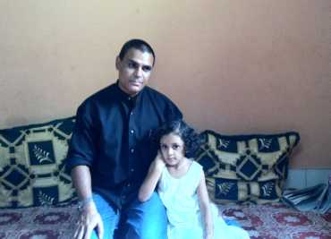 Mohammed Jaweed Azmath with his daughter