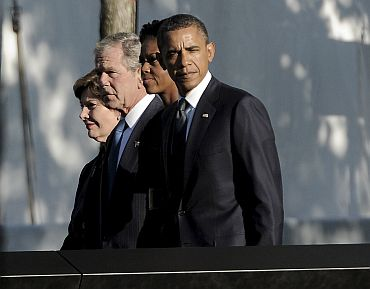 US President Barack Obama, first lady Michelle Obama, former president George W Bush and Mrs Laura Bush walk past the North Pool at the National September 11 Memorial during tenth anniversary ceremonies at the World Trade Center site in New York