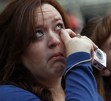 People react during ceremonies marking the 10th anniversary of the 9/11 attacks on the World Trade Center, in New York