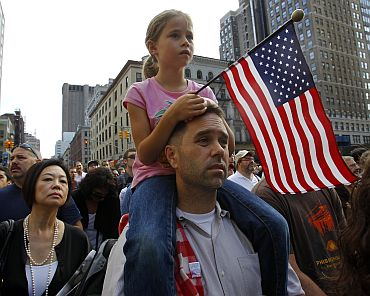 People stand on Church Street in lower Manhattan to listen to the ceremony