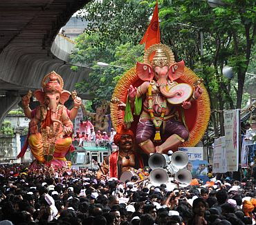 Thousands of people assembled on the streets in Mumbai to see the idols of their 'Lord Ganesha' being immersed.