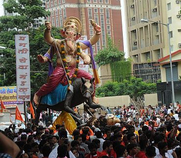 Devotees welcome another Ganpati immersion procession in Mumbai