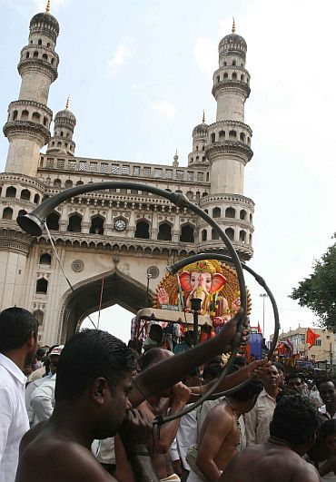 A Ganpati immersion procession underway near Charminar in Hyderabad on Sunday