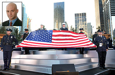 An American flag is unfurled during ceremonies marking the 10th anniversary of the 9/11 attacks on the World Trade Center in New York. Inset: Stephen Tankel