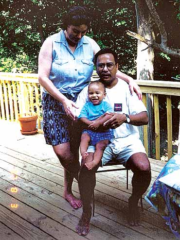 Young Santi with his parents Nancy and Jupiter Yambem