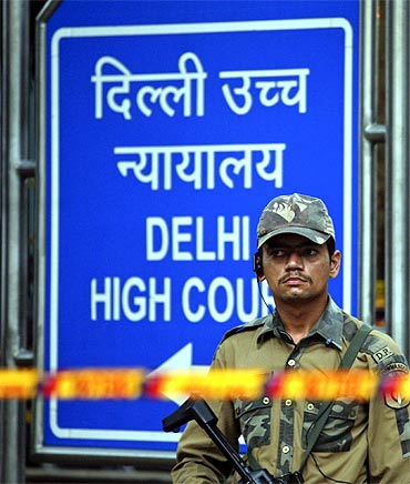 A police commando stands guard outside the Delhi high court after the blast