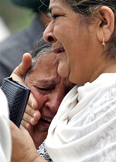 Relatives mourn the death of Inder Singh, who was killed in Wednesday's bomb blast