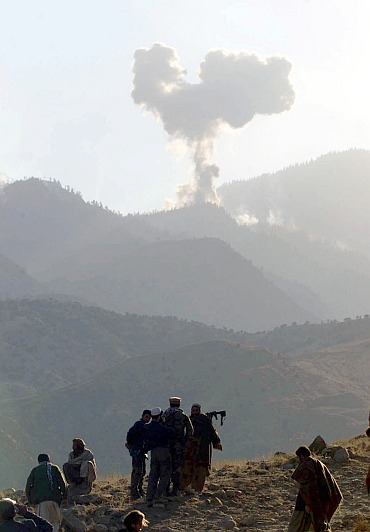 Smoke from United States bombing is seen at a command post in the Tora Bora mountains