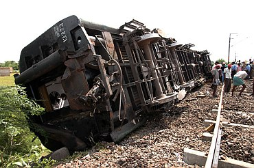 Railway workers at the mishap site