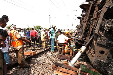 Railway authorities with rescue workers at the site