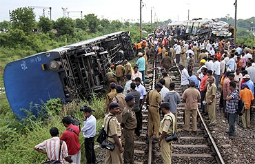 Railway officials and police at the accident site