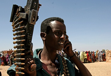 A Somalian militant talks on his mobile phone in Rabdure district, 400 km (248 miles) west of Somalian capital Mogadishu