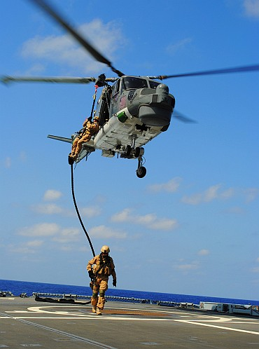 Estonian marines 'fast-rope' from a Sea Lynx MK 88 helicopter onto the helicopter flight deck aboard the German Frigate 'Hamburg' off the coast of Djibouti