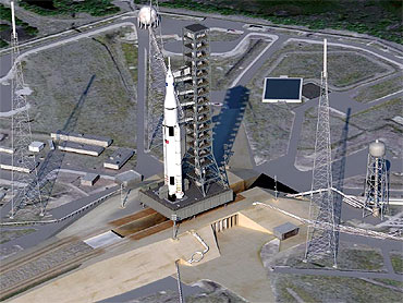 Artist concept of SLS on launchpad. (NASA)