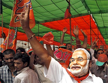 Modi's supporters participate in a BJP rally