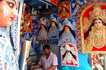 Artists at Kumartuli preparing thermocol decorations for Durga idols and pandals