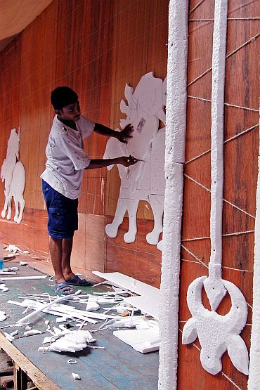 An artist busy decorating the pandal of the 74 Pally Sarbojonin Durgotsab in Kolkata