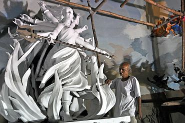 Another idol of Maa Durga being decorated by an artist in Kolkata