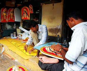 Kumartuli artists busy creating the wondeful accessories which further beautify Maa Durga's idol and the pandal
