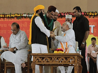 Muslims greet Gujarat Chief Minister Narendra Modi during his sadbhavana fast in 2011.