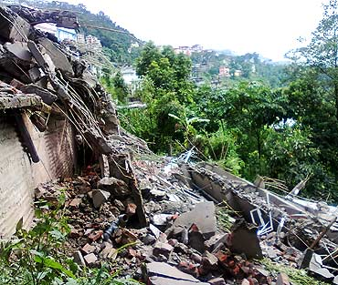 The debris of a residential building in Lumsey in Gangtok