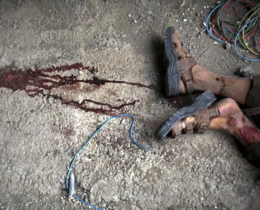 A dead Taliban insurgent is seen after he was killed inside a building which militants took over near the US embassy in Kabul