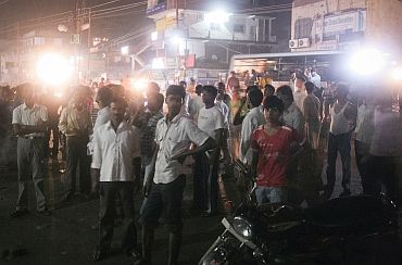 Residents stand together outdoors after an earthquake tremor in Patna