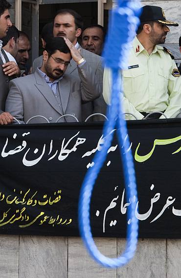 Tehran Prosecutor General Saeed Mortazavi adjusts his hair as he attends an execution by hanging in Tehran