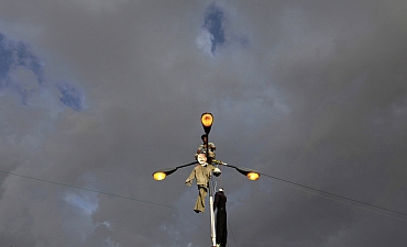 An effigy of Yemen's President Ali Abdullah Saleh is hung on a street lamp by a protester in Sanaa