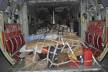 Soldiers load relief material for earthquake victims onto a plane at the Hindon air force station on the outskirts of New Delhi