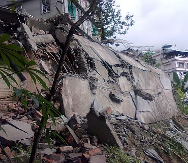 Debris of a residential building is seen after the earthquake in Lumsey near Gangtok
