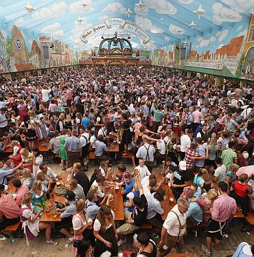 A general view shows a crowded beer tent during the opening day of the Oktoberfest 2011 beer festival at Theresienwiese