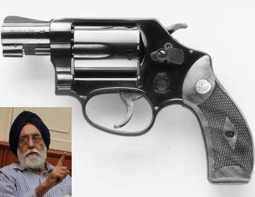 S&W revolver. (Inset) M S Gill