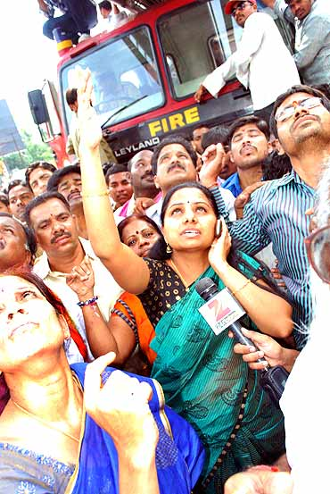 Crowds gathered outside the college as Srinivas refused to budge