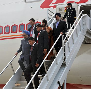 PM Singh arrives at the JFK airport in New York on Thursday wife Gursharan Kaur and ambassadors Nirupama Rao and Hardeep Puri