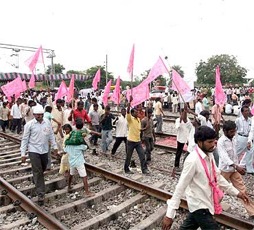 TRS activists at the site of a rail roko agitation on Saturday