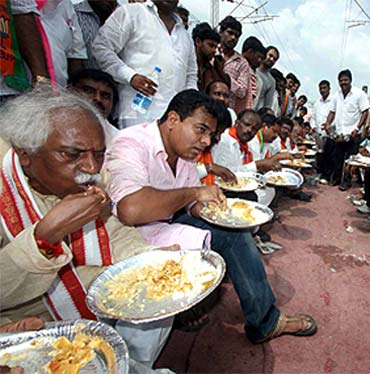 TRS leaders having their meals on the rail tracks during the agitation on Saturday