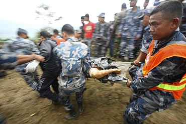 Armed police force transport bodies of the victims of Buddha Air plane crash in Lalitpur