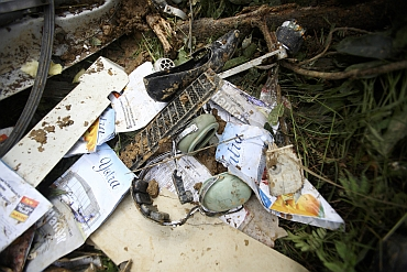 Belongings of victims are seen at the scene of the Buddha Air plane crash in Lalitpur