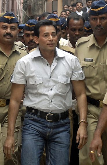 Salem is surrounded by policemen as he arrives at a court in Hyderabad