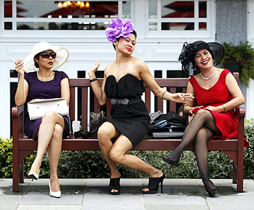 Race-goers strike a pose before the running of the Melbourne Cup