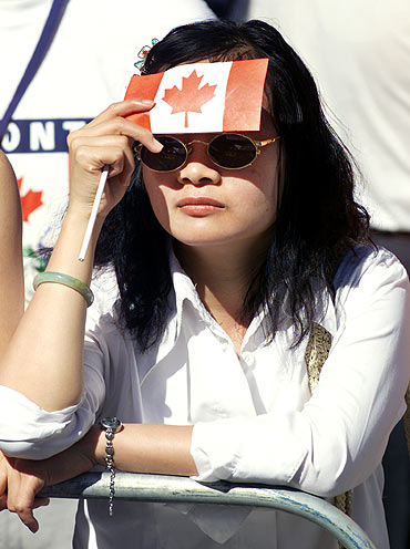 A Toronto woman shields her face from the sun
