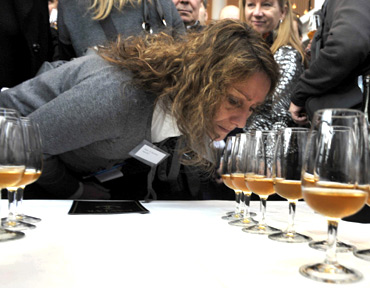 A woman smells samples of champagne in Mariehamn, Finland