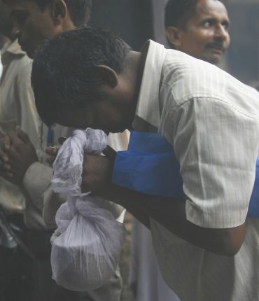 A relative of a Mumbai blasts victim prays at the crematorium