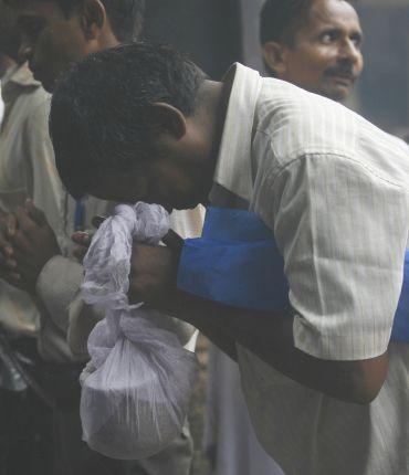 A relative of a Mumbai blasts victim prays at the crematorium